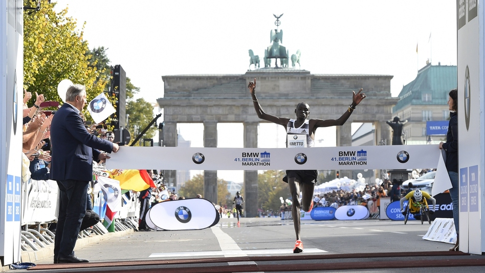 Kenya's Dennis Kimetto crosses the finish line to win the Berlin Marathon Sunday. Kimetto set a new world marathon record, breaking the 2 hour, 3 minute mark for the first time. (Tobias Schwarz/AFP/Getty Images)
