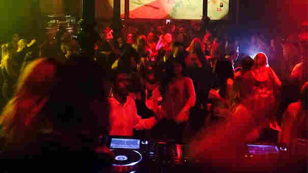 Clubgoers dance at a Stockholm club that forbade its patrons from drinking Friday night.