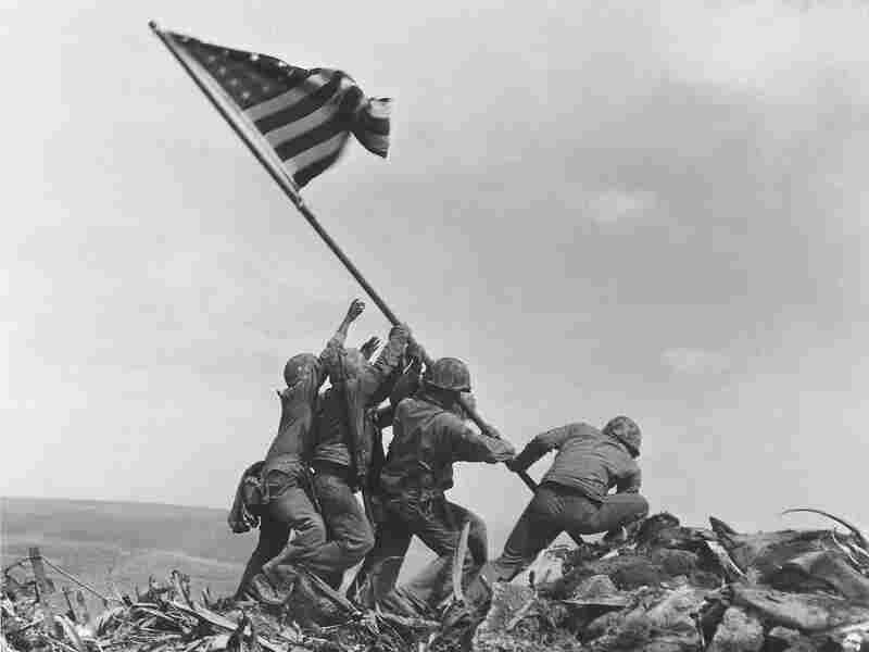 U.S. Marines raise the American flag atop Mount Suribachi, Iwo Jima, on Feb. 23, 1945. The generation who fought in World War II is often called the GI generation or the greatest generation.