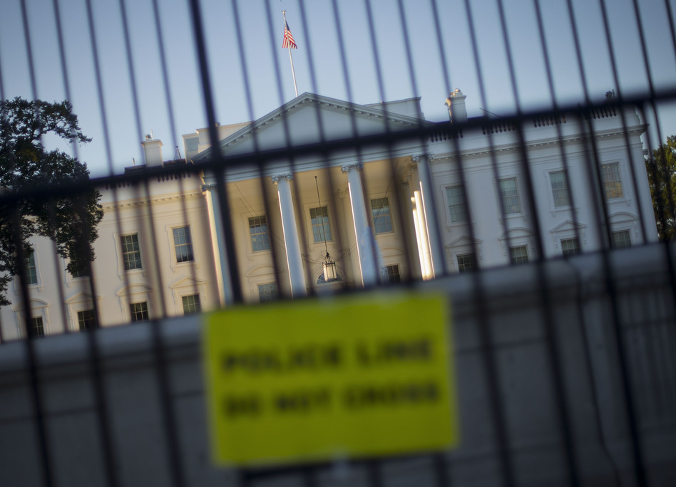 A perimeter fence has been placed in front of the White House fence on the North Lawn along Pennsylvania Avenue in Washington. (Pablo Martinez Monsivais/AP)