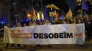 Pro-independence Catalans protest in front of a Spanish government delegation in Barcelona Monday, after Spain's Constitutional Court suspended an independence referendum called by Catalonia.