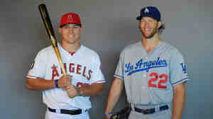 Mike Trout and Los Angeles Angels have been named favorites to reach the World Series, as have Clayton Kershaw and the Los Angeles Dodgers. They're seen here when the two teams played in August.