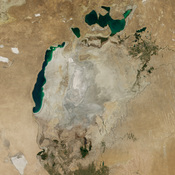 Images from August 2000 (left) and August 2014 (right) show the drop in water levels in the Aral Sea.