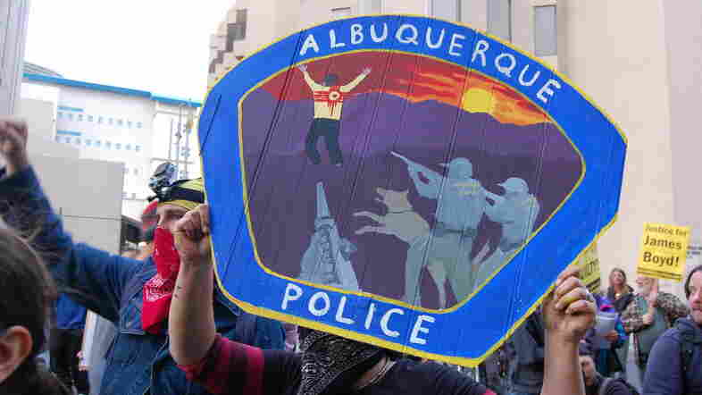 Protesters gather outside the Albuquerque police department following the shooting deaths of James Boyd and others on March 25. The Justice Department accused the police of engaging in a pattern of excessive force.