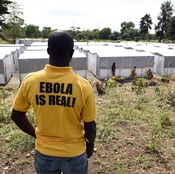A man stands above a new Ebola treatment center in Monrovia, Liberia. Health workers in Liberia, the hardest-hit nation, have turned people away from treatment units because of shortages of beds and staff.