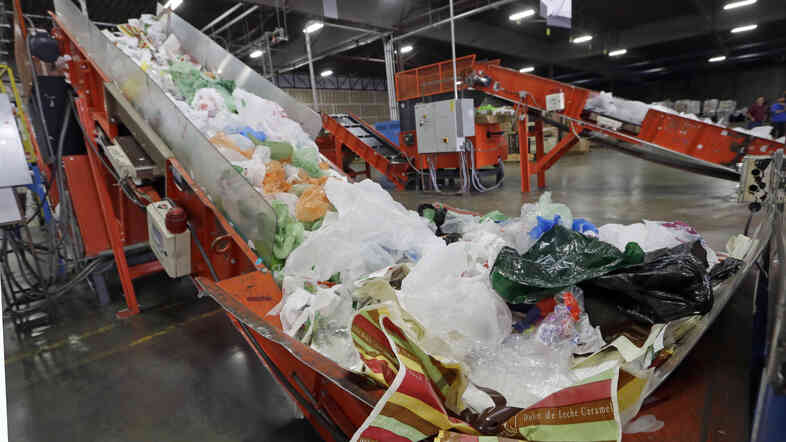 California Gov. Jerry Brown has signed the nation's first state-wide ban on single-use plastic bags. Here, mixed plastic items are seen at a recycling plant in Vernon, Calif., earlier this year.