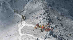 Japan Self-Defense Force (JSDF) soldiers and firefighters conduct rescue operations near the peak of Mt. Ontake, on Wednesday.