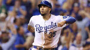 Eric Hosmer No. 35 of the Kansas City Royals reacts after scoring on a single by Christian Colon in the 12th inning against the Oakland Athletics during the American League Wild Card game in Kansas City.