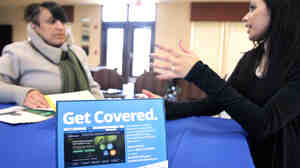 In New Jersey in March, Dianna Lopez of the Center for Family Services (right) speaks with Betsy Cruz, of Camden, N.J., about health insurance coverage during an Affordable Care Act information sess