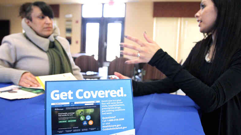 In New Jersey in March, Dianna Lopez of the Center for Family Services (right) speaks with Betsy Cruz, of Camden, N.J., about health insurance coverage during an Affordable Care Act information session.