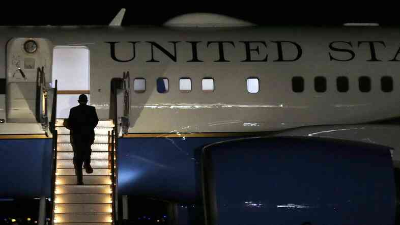 President Obama boards Air Force One after attending a Democratic fundraiser in Newport, R.I. in August. Ahead of this fall's midterm elections, he's not doing big public rallies for Democratic candidates, instead opting for private events.