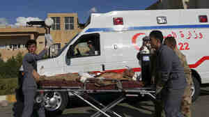A Kurdish peshmerga soldier who was wounded Sept. 30 in fierce battles in nearby Nineveh province with Islamic State group militants is brought to the Zakho Emergency Hospital in Dahuk, Iraq.