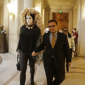 "San Francisco City Supervisor David Campos (right) walks with drag queen Sister Roma to a news conference on Sept. 17 about a Facebook policy that requires people to use their ""real"" names on their profiles. The site said Wednesday it will modify how the policy is enforced."