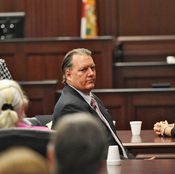 Michael Dunn, center, looks back at his parents after a jury found him guilty in his retrial.