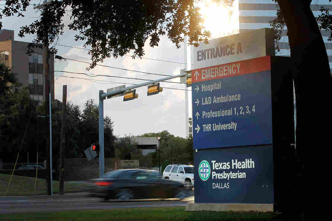 Traffic moves past Texas Health Presbyterian Hospital in Dallas, where a patient showed up with symptoms that were later confirmed to be Ebola.