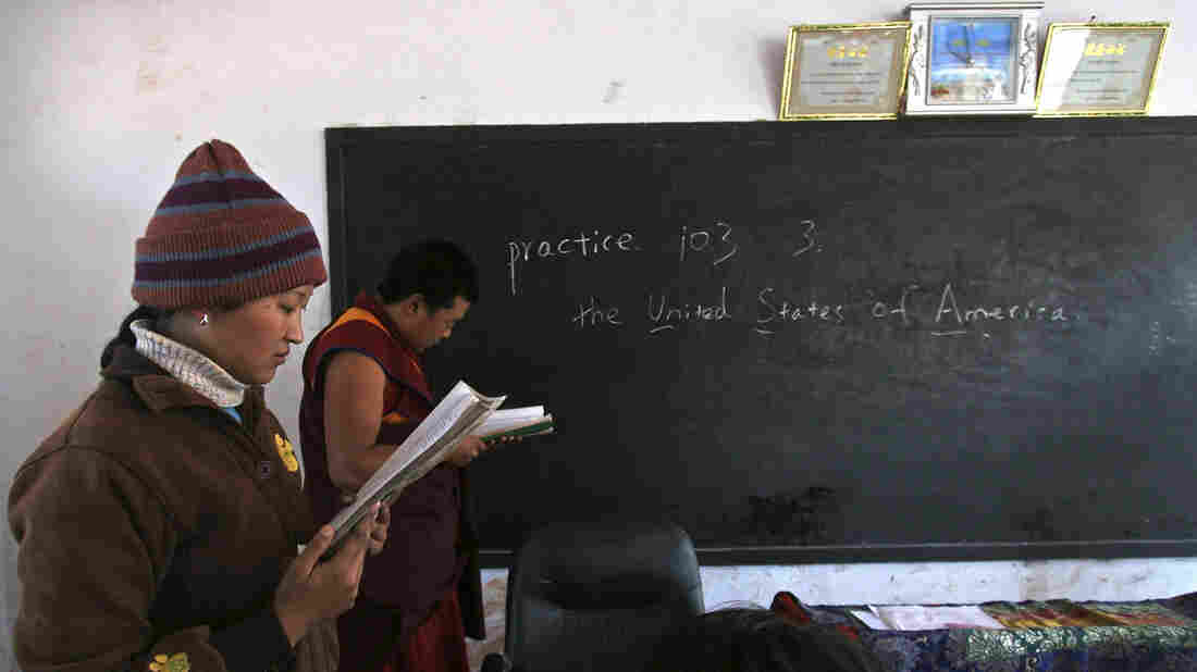 English-language students in China practice their blackboard skills.