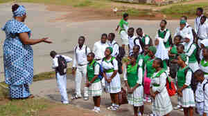 Secondary students learn about Ebola during an assembly in Abuja. Nigeria's schools have reopened after being closed to prevent the spread of the disease.