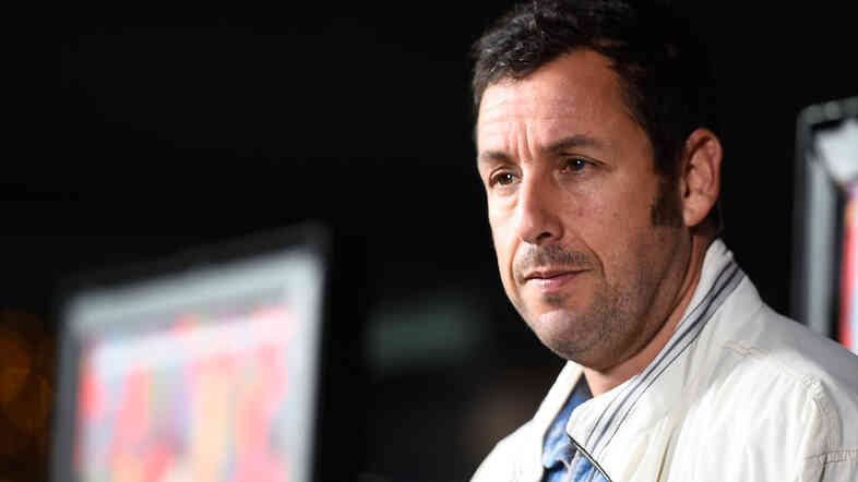"Adam Sandler, seen here at the recent premiere of Jason Reitman's Men, Women & Children, probably didn't mean it when he said he signed on with Netflix because it rhymes with ""wet chicks."""