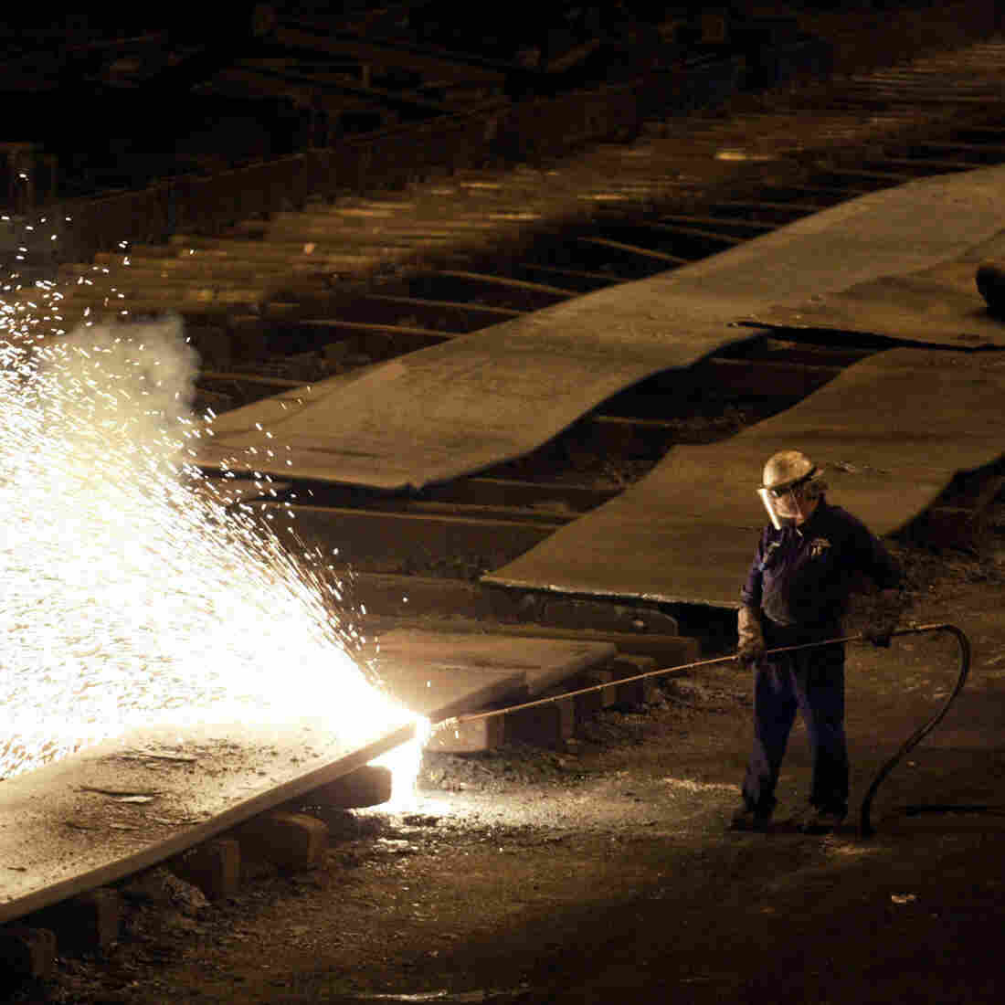 A worker cuts slabs of steel at a mill in Cleveland in 2004.