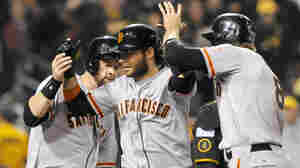 San Francisco Giants' Brandon Crawford (center) is greeted by teammates Brandon Belt (left) and Hunter Pence after hitting a grand slam against the Pittsburgh Pirates in the fourth inning of Wednesday night's game.