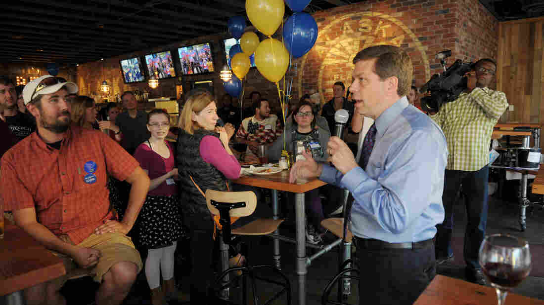 Sen. Mark Begich, right, D-Alaska, speaks to supporters in Anchorage in August 2014. He's hoping to hold on to his seat in the Republican-leaning state.