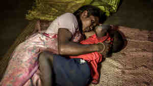 Seteng Horo with her son Abhishek, 4, in their two-room mud hut. Seteng is married to Kunwar. The couple has two children. Their daughter is 6.