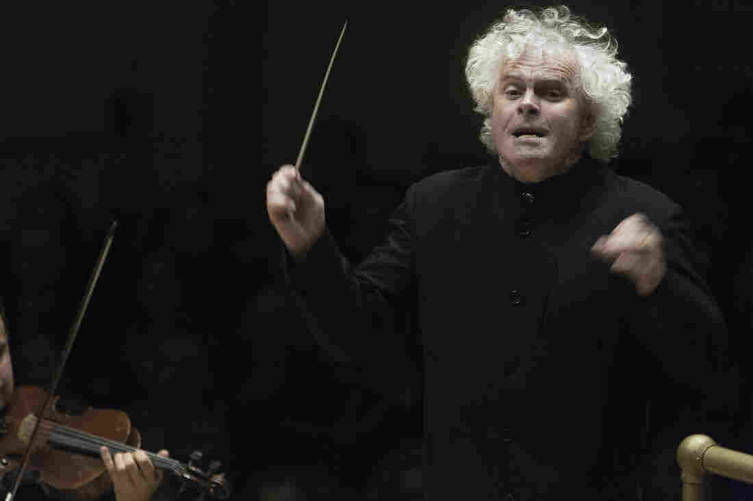 Conductor Simon Rattle leads the Berlin Philharmonic at Carnegie Hall on October 1, 2014.
