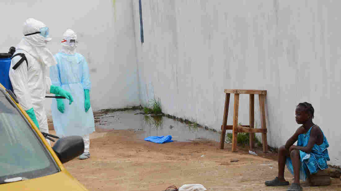 A girl cries outside an Ebola treatment center in Monrovia in late September. Both her parents died in the Ebola outbreak.
