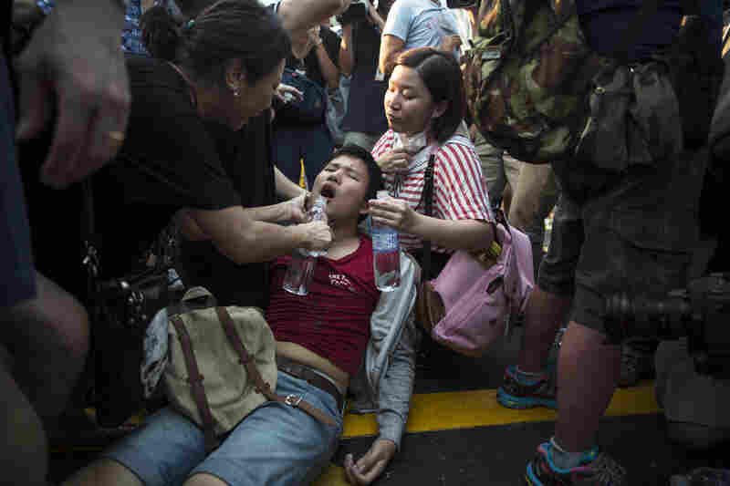 A student protester suffering from heat stroke is given water in Mong Kok.