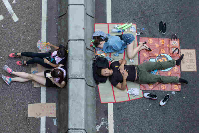 Pro-democracy protesters sleep on a street in Hong Kong.