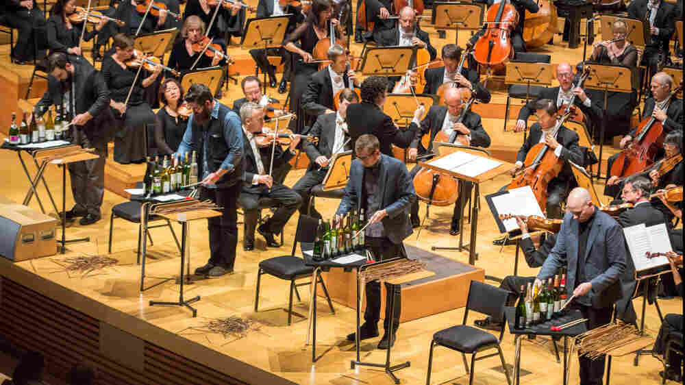 Members of the ensemble So Percussion join conductor Gustavo Dudamel for the U.S. premiere of David Lang's man made at Walt Disney Concert Hall.