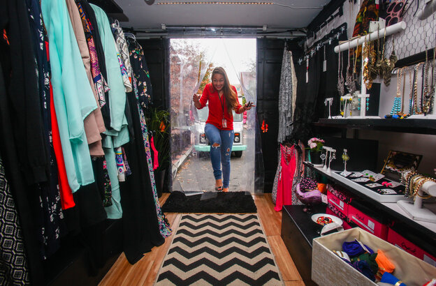 Christina Bui climbs up the steps of Street Boutique. Owner Lia Lee offers jewelry, bags, scarves, clothing and shoes, and changes her inventory often.