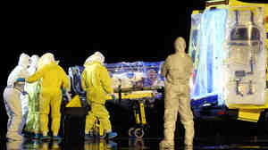 When a high-risk patient is evacuated, strict precautions are followed. Above, aid workers and doctors in protective gear transfer Manuel Garcia Viejo, a Spanish priest diagnosed with Ebola, to a waiting ambulance at a Madrid airport.