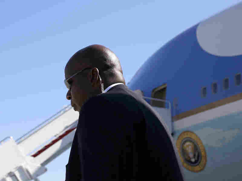 A Secret Service agent stands watch near Air Force One in August.