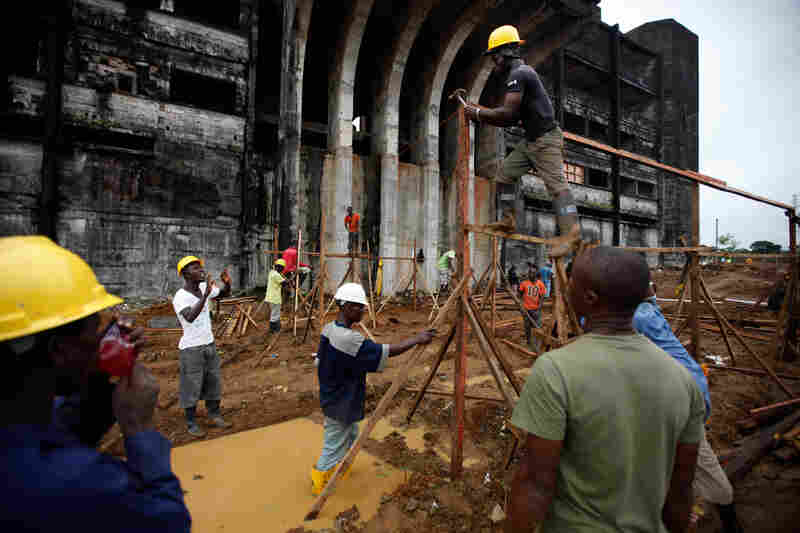 The construction of a 300-bed Ebola treatment unit is underway in front of the former Ministry of Defense building in Monrovia, Liberia's capital.