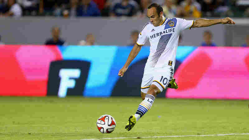 Landon Donovanof the Los Angeles Galaxy shoots the ball against Vancouver FC at StubHub Center on August 23, 2014.