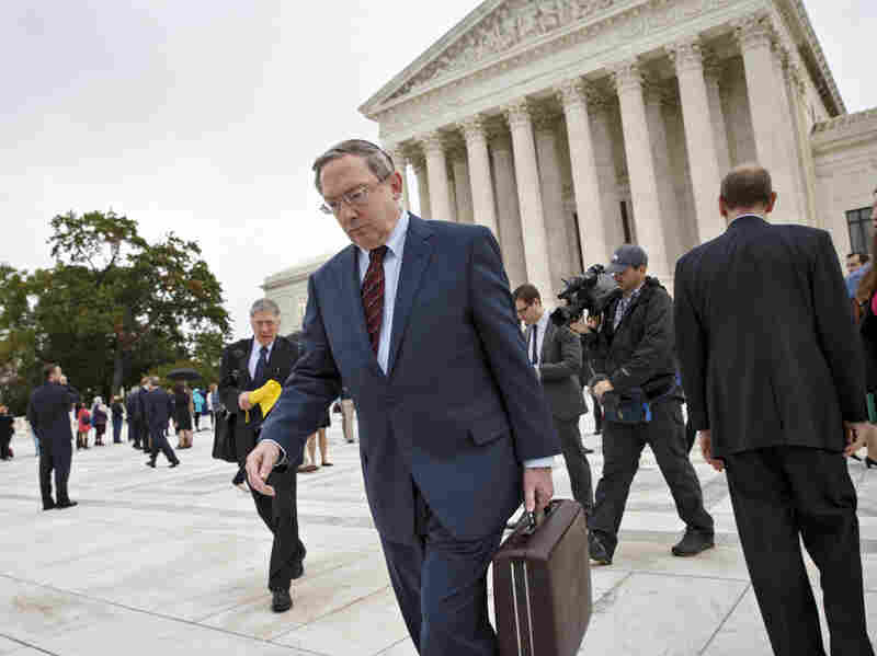 Attorney Douglas Laycock leaves the Supreme Court Tuesday after arguing before the court on behalf of Arkansas prison inmate Gregory Holt.