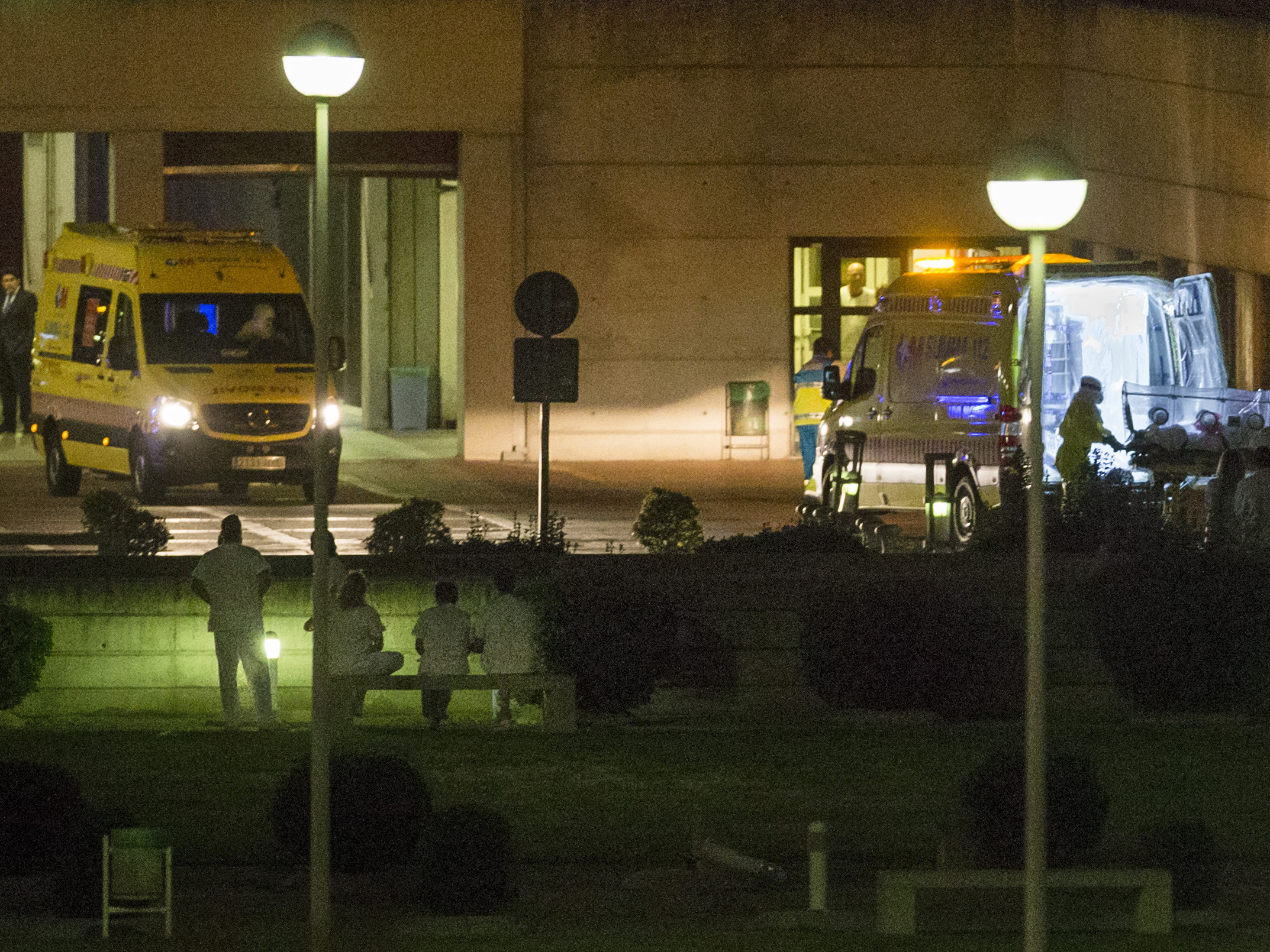 Medical personnel carry a Spanish nurse who contracted the Ebola virus into an ambulance at Madrid's Alcorcon Hospital on Tuesday.