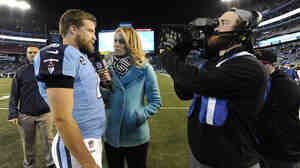 NFL sideline reporter Alex Flanagan (center) interviews Tennessee Titans quarterback Ryan Fitzpatrick last year.