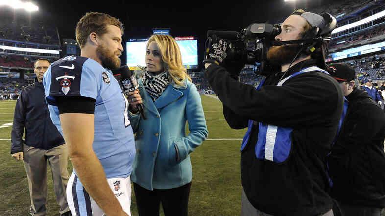 NFL sideline reporter Alex Flanagan (center) interviews Tennessee Titans quarterback Ryan Fitzpatrick last year.