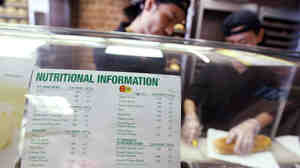 A sign displaying calorie counts is seen in a Subway restaurant in New York City