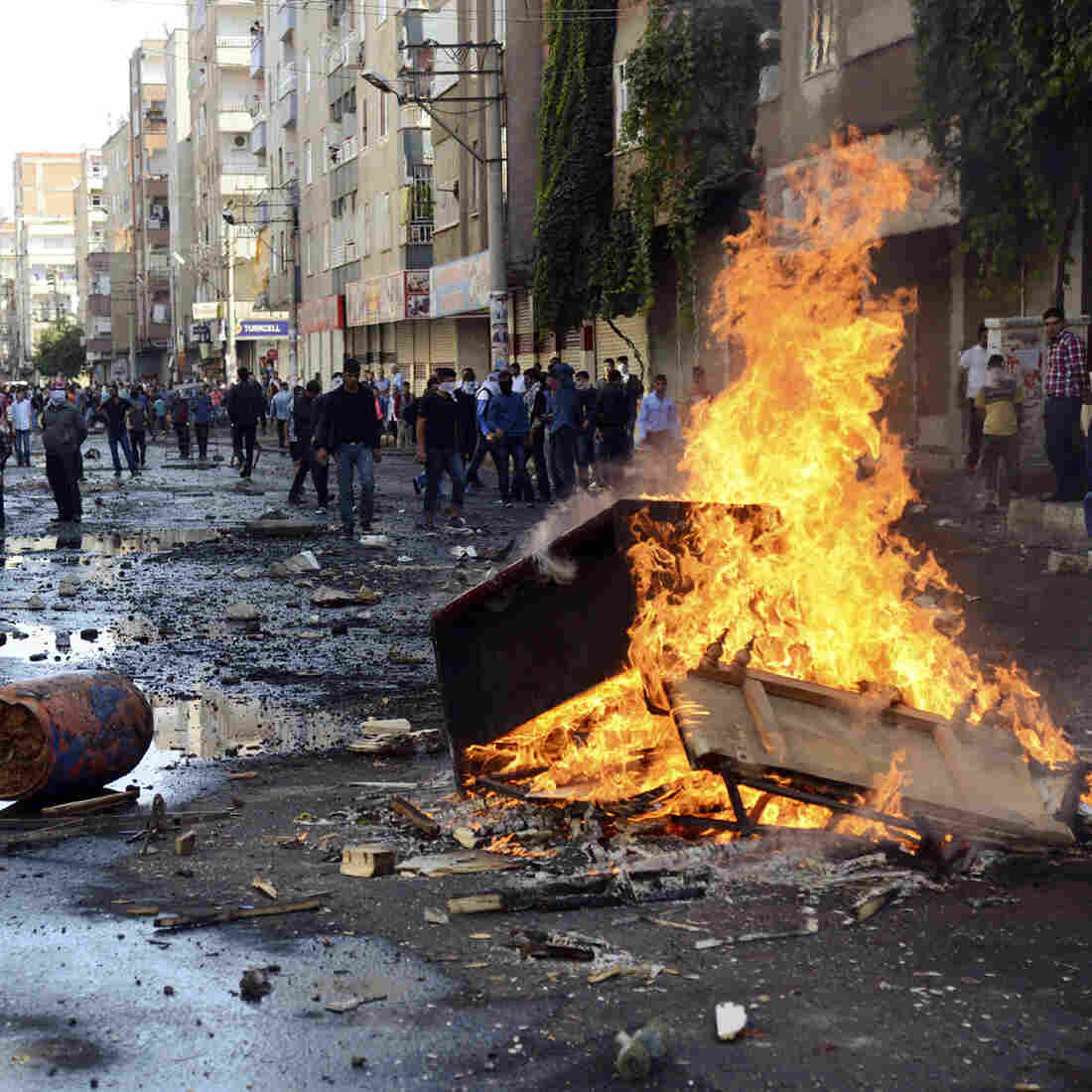 Kurdish protesters set fire to a barricade set up to block the street as they clash with riot police in Diyarbakir, Turkey, on Wednesday.