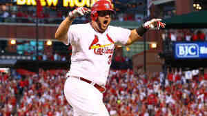 Matt Adams of the St. Louis Cardinals reacts after hitting a three-run home run in the seventh inning against the Los Angeles Dodgers in Game 4 of the National League Division Series.