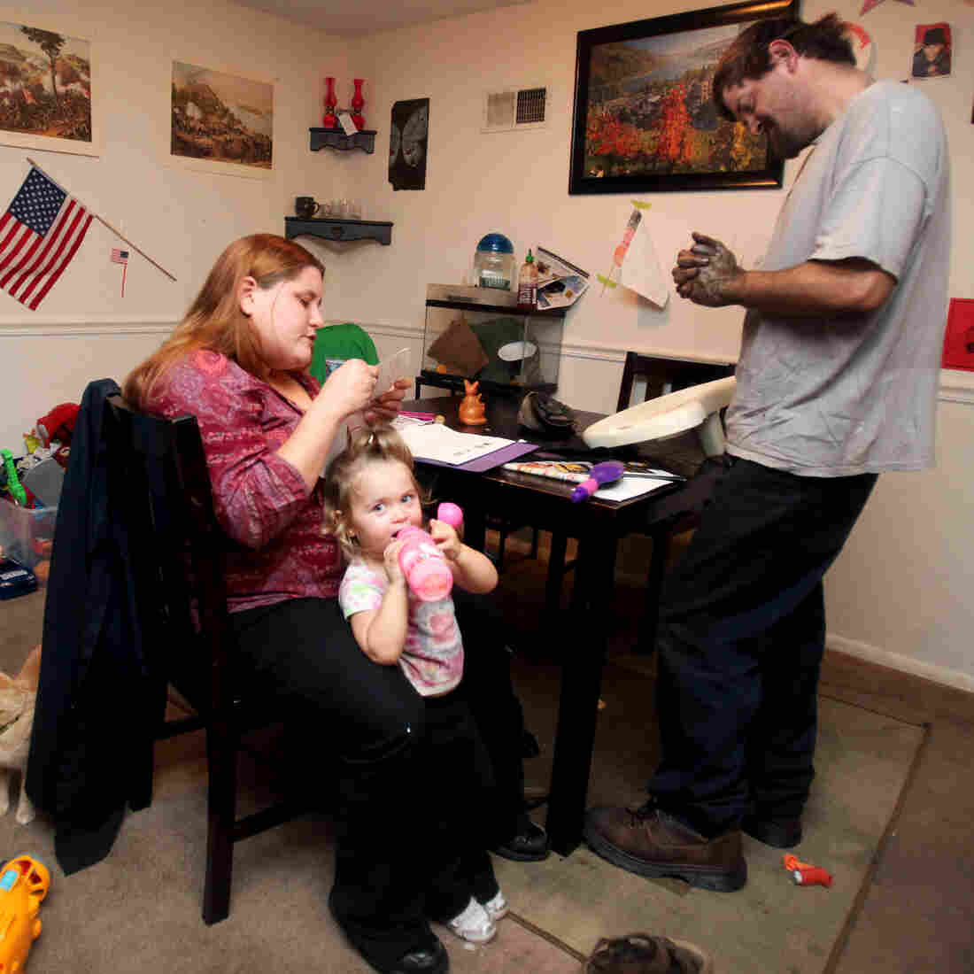 Phillip Underwood and Michelle Sheridan and their children, Logan and Lilliana, gather in their living room in Frederick, Md., after a long day of work and school. The couple had delayed marriage, in part for financial reasons.