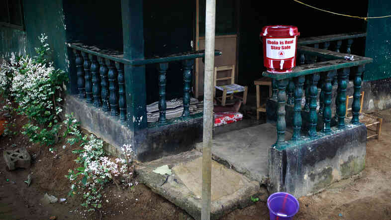 The home of Marthalene Williams, the Ebola-stricken woman aided by Thomas Eric Duncan. A man on the porch, who appeared to be in the late stages of Ebola, informed our photographer that he'd been to a hospital but was told to return home and quarantine himself.
