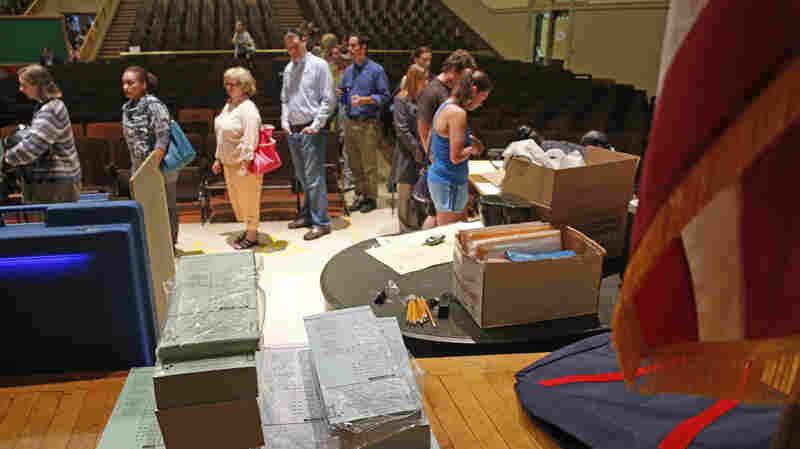 Ballots are stacked and ready as voters wait in line during the 2012 primaries in Milwaukee. An appeals court ruled Monday that a Wisconsin voter ID law, on hold since 2011, could go into effect, but the Supreme Court stepped in on Thursday night to halt the law again as it decides whether to take the case.