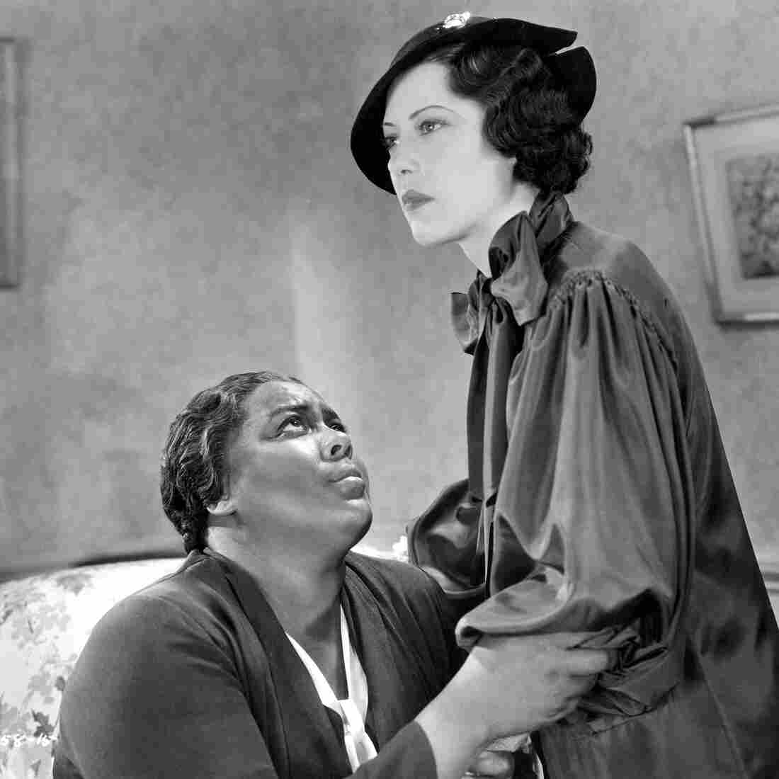 In the 1934 film Imitation of Life, Fredi Washington (right) plays the role of Peola, an African-American woman who decides to pass as white.