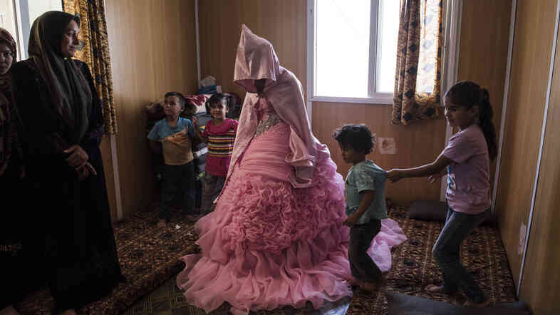 "This year, Lynsey Addario photographed 13-year-old Rahaf Yousef, a Syrian refugee, at her engagement party at a camp in Jordan. ""Syrian refugees typically marry young,"" says Addario. ""It's been exacerbated by the war. Families are scared something might happen to their daughter. They prefer to marry them earlier so they're under the protection of a husband."""