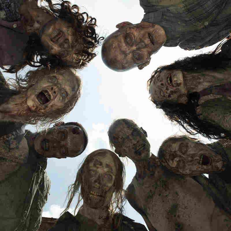 "A crowd of zombies, known as ""walkers,"" on AMC's The Walking Dead."