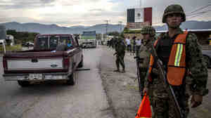 Groups of rural and community police arrive in the city of Iguala on Tu